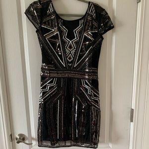 Black sequin cap sleeve dress